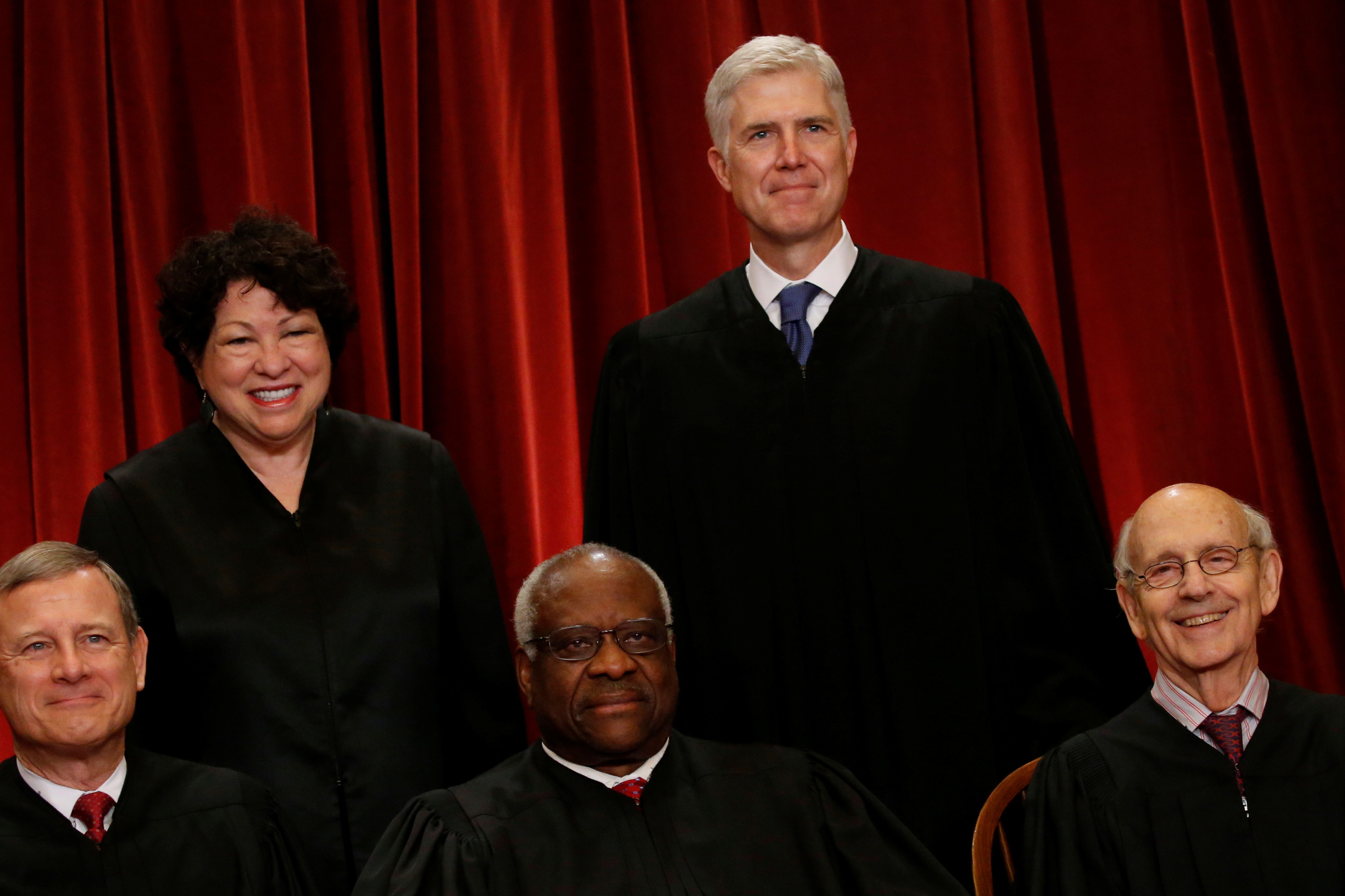 U.S. Supreme Court Justice Neil Gorsuch (top R) smiles as he joins his fellow justices, including Chief Justice John Roberts (L-R), Justice Sonia Sotomayor, Justice Clarence Thomas and Justice Stephen Breyer, in taking a new family photo including Gorsuch, their most recent addition, at the Supreme Court building in Washington, D.C. REUTERS/Jonathan Ernst