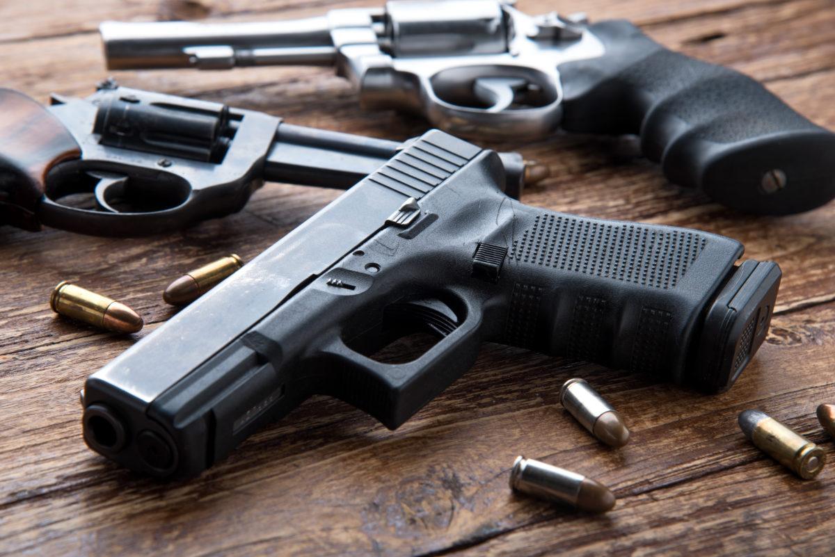 Handguns on a table (Shutterstock)