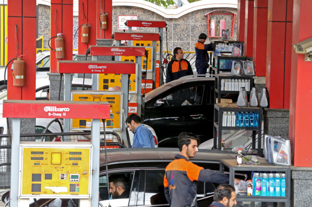 "Iranians drivers fill their tanks at a gas station in the capital Tehran on November 5, 2018. - Iran's President Hassan Rouhani said the Islamic republic ""will proudly bypass sanctions"" by the United States that took effect on Monday targeting the country's oil and financial sectors. ATTA KENARE/AFP/Getty Images)"
