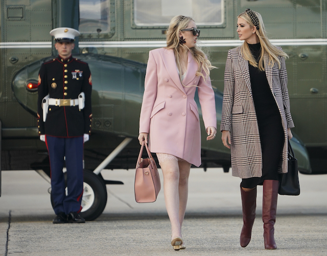 US President Donald Trump's daughters Tiffany Trump, and Ivanka Trump (R) make their way to board Air Force One before departing from Andrews Air Force Base in Maryland for Palm Beach, Florida, on November 20, 2018. - Trump will be spending the Thanksgiving holiday at his Mar-a-Lago resort in Florida. (Photo credit: MANDEL NGAN/AFP/Getty Images)