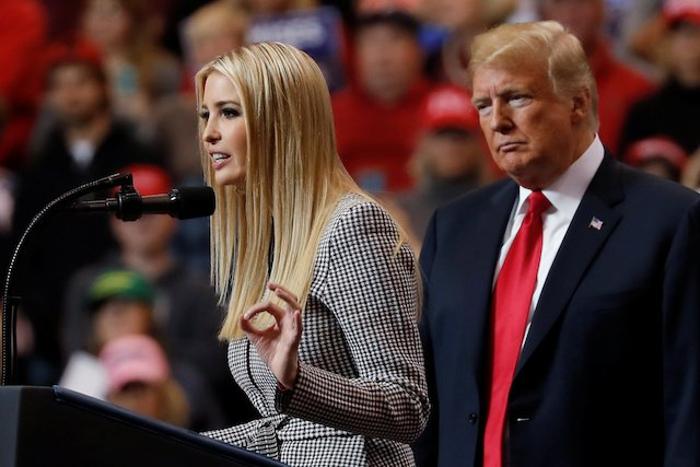 U.S. President Donald Trump listens as his daughter, White House senior adviser Ivanka Trump, speaks during a campaign rally in Cleveland, Ohio., U.S., November 5, 2018. REUTERS/Carlos Barria