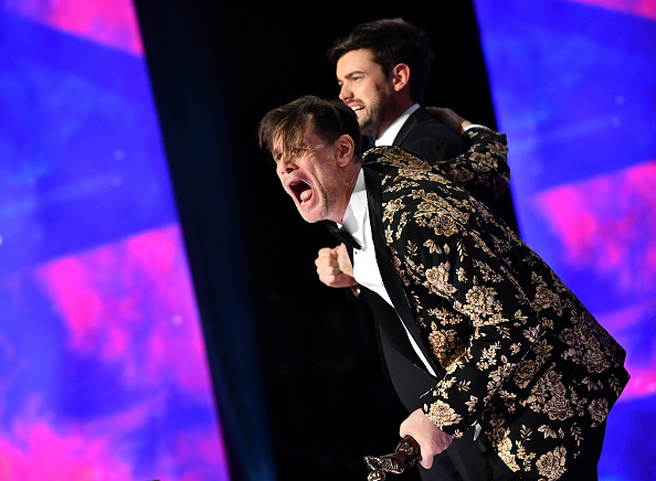 BEVERLY HILLS, CA - OCTOBER 26: Jack Whitehall (L) and Jim Carrey (R) on stage at the 2018 British Academy Britannia Awards presented by Jaguar Land Rover and American Airlines at The Beverly Hilton Hotel on October 26, 2018 in Beverly Hills, California. (Photo by Emma McIntyre/BAFTA LA/Getty Images for BAFTA LA)