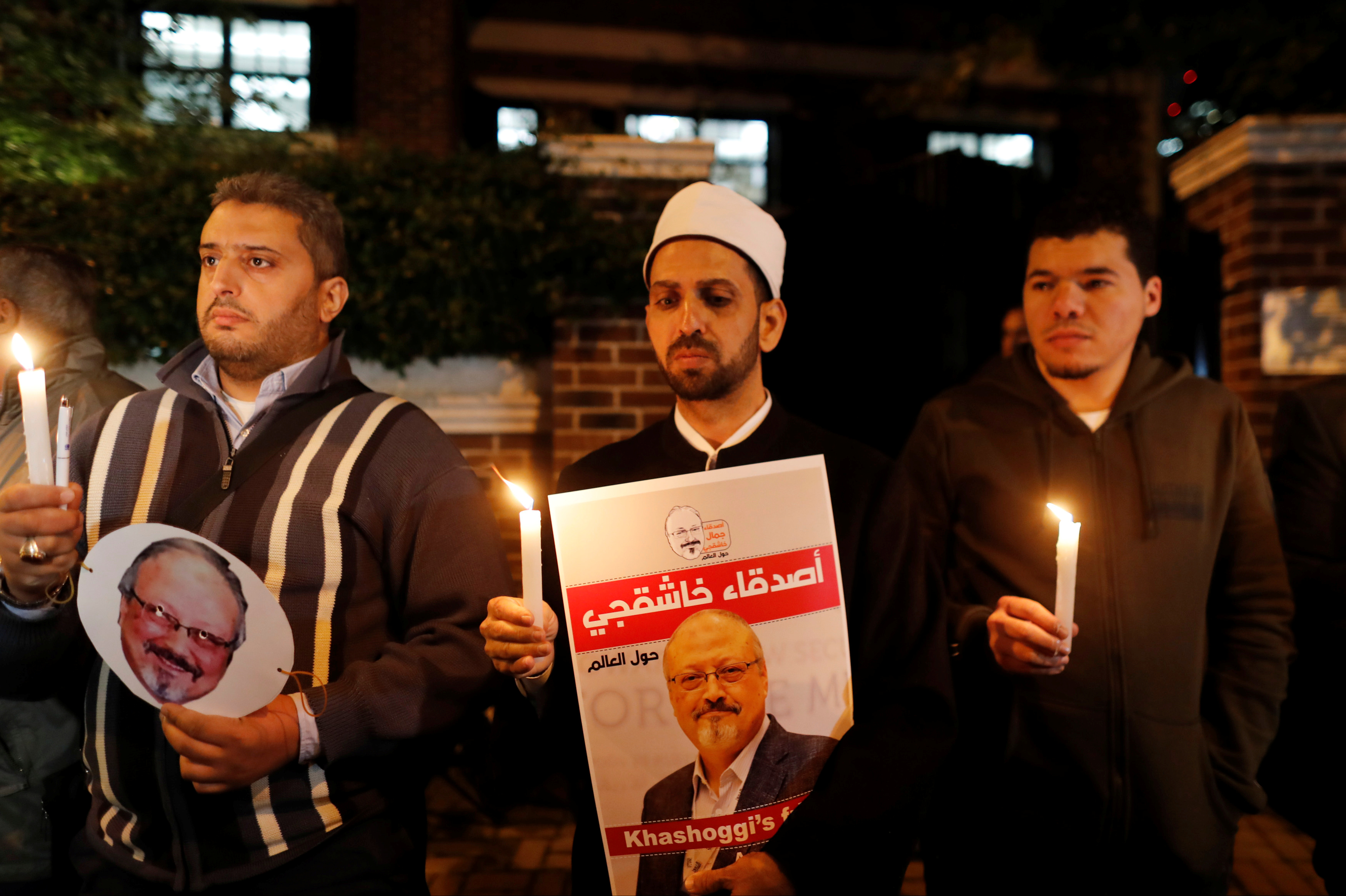 Demonstrators hold posters with picture of Saudi journalist Jamal Khashoggi outside the Saudi Arabia consulate in Istanbul
