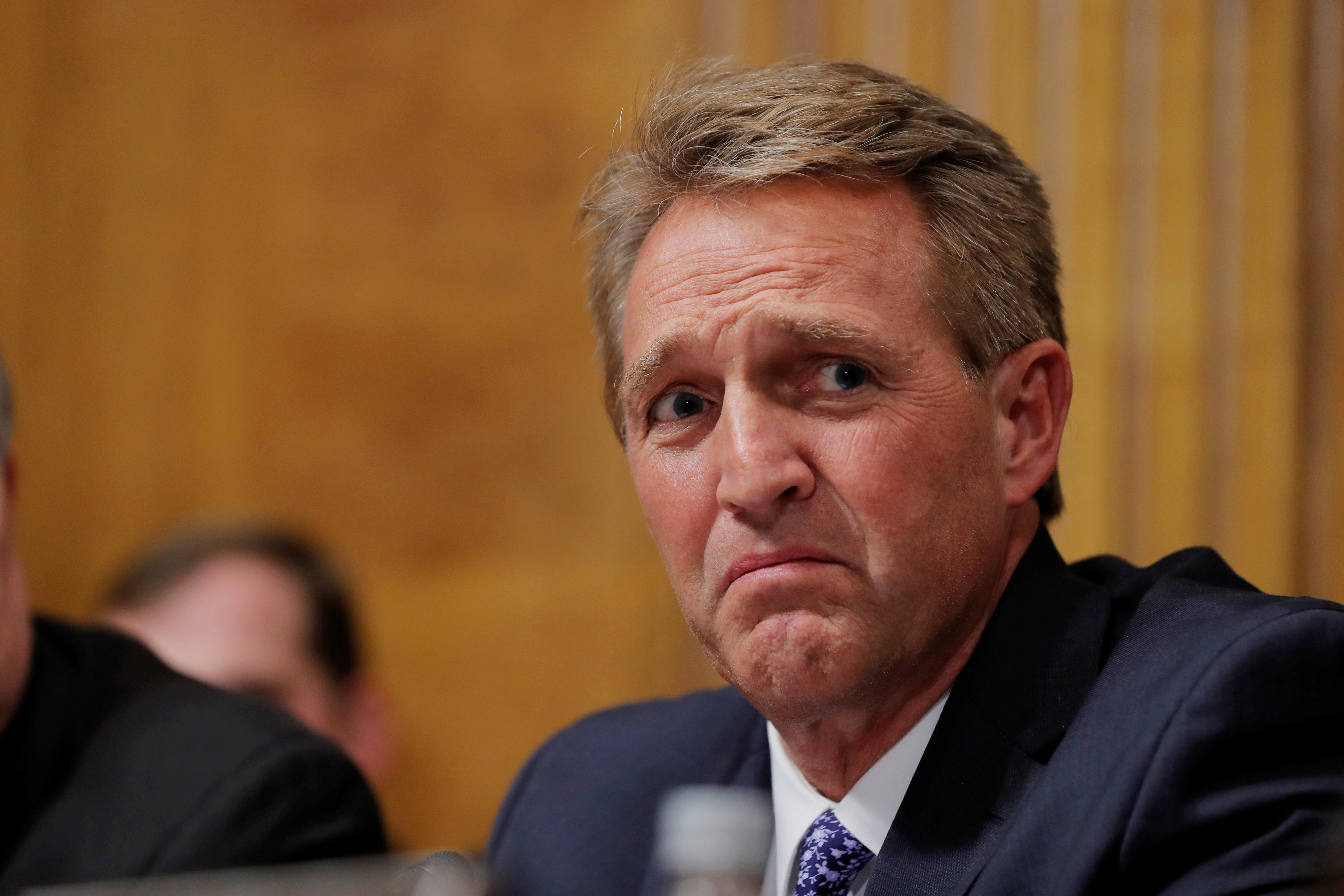 U.S. Senator Jeff Flake (R-AZ) looks on during a Senate Judiciary Committee confirmation hearing for U.S. Supreme Court nominee Brett Kavanaugh on Capitol Hill in Washington, U.S., September 27, 2018. REUTERS/Jim Bourg