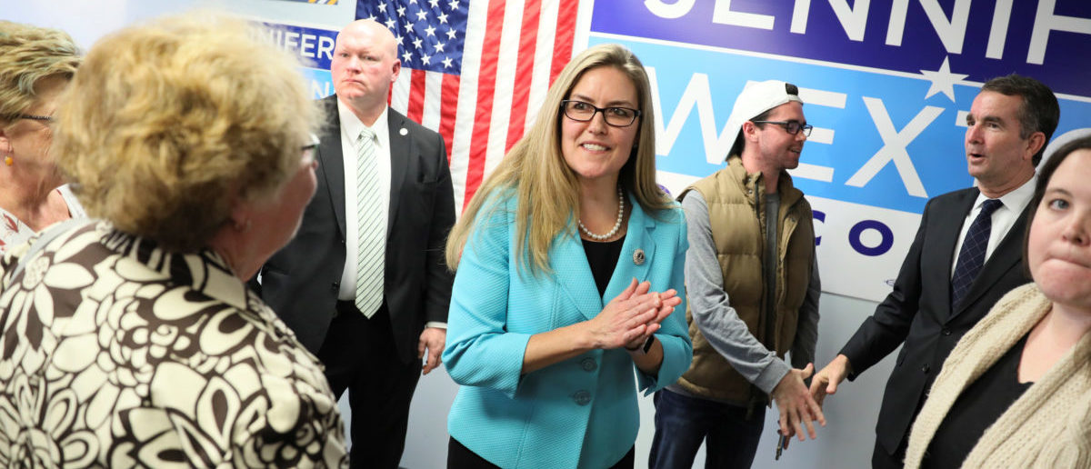 Virginia Democratic candidate for U.S. Representative Jennifer Wexton and Virginia Gov. Ralph Northam (2nd R) greet supporters at a campaign rally in Sterling, Virginia, Oct. 30, 2018. REUTERS/Jonathan Ernst