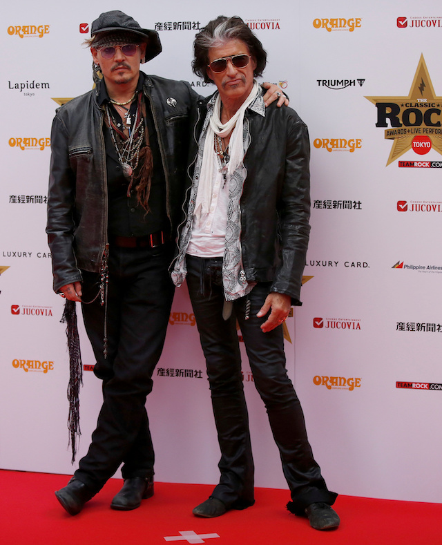 Johnny Depp (L) and Aerosmith's guitarist Joe Perry pose on the red carpet at the 2016 Classic Rock Roll of Honour awards in Tokyo, Japan, November 11, 2016. REUTERS/Toru Hanai