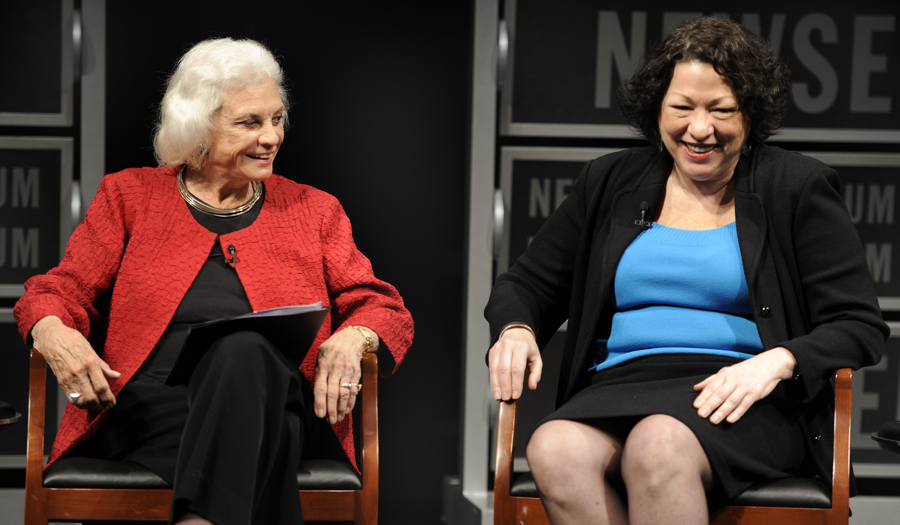 The first female supreme court justice, Sandra Day O'Connor (L), and fellow Justice Sonia Sotomayor share a light-hearted moment during a forum at the Newseum in Washington, DC, April 11, 2012, to mark the 30th anniversary of O'Connor's first term on the Supreme Court. REUTERS/Mike Theiler