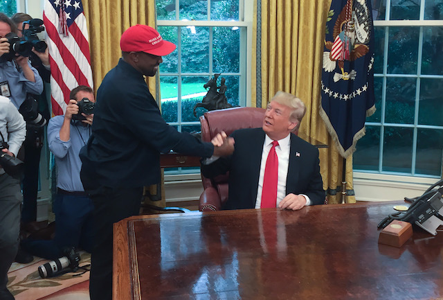 US President Donald Trump meets with rapper Kanye West in the Oval Office of the White House in Washington, DC, October 11, 2018. (Photo credit: SEBASTIAN SMITH/AFP/Getty Images