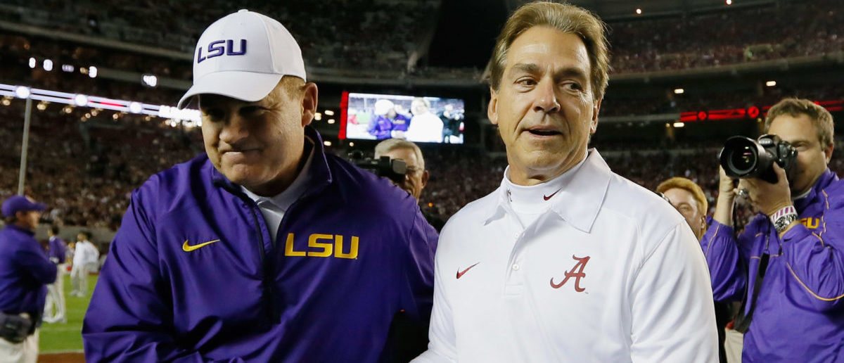 TUSCALOOSA, AL - NOVEMBER 09: (L-R) Head coach Les Miles of the LSU Tigers shakes hands with head coach Nick Saban of the Alabama Crimson Tide before the game at Bryant-Denny Stadium on November 9, 2013 in Tuscaloosa, Alabama. (Photo by Kevin C. Cox/Getty Images)