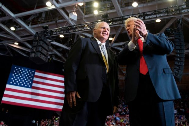 US President Donald Trump alongside radio talk show host Rush Limbaugh arrive at a Make America Great Again rally in Cape Girardeau, Missouri on November 5, 2018. (JIM WATSON/AFP/Getty Images)