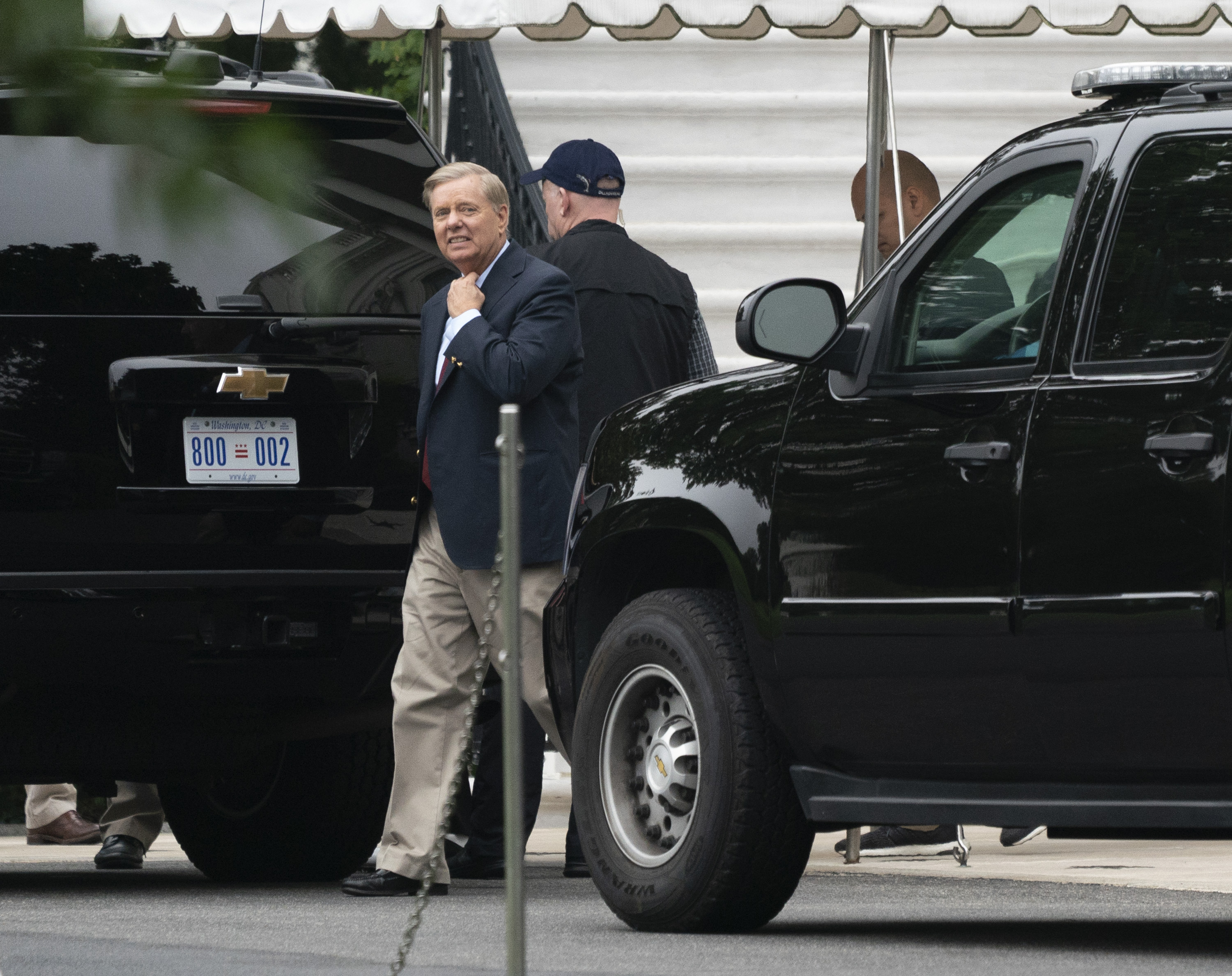 Senator Lindsey Graham (R-SC) boards a motorcade at the White House on October 7, 2018 in Washington, DC. Graham is going golfing at Trump National Goff Course with U.S. President Donald Trump in Sterling, Virginia. (Kleponis-Pool/Getty Images)