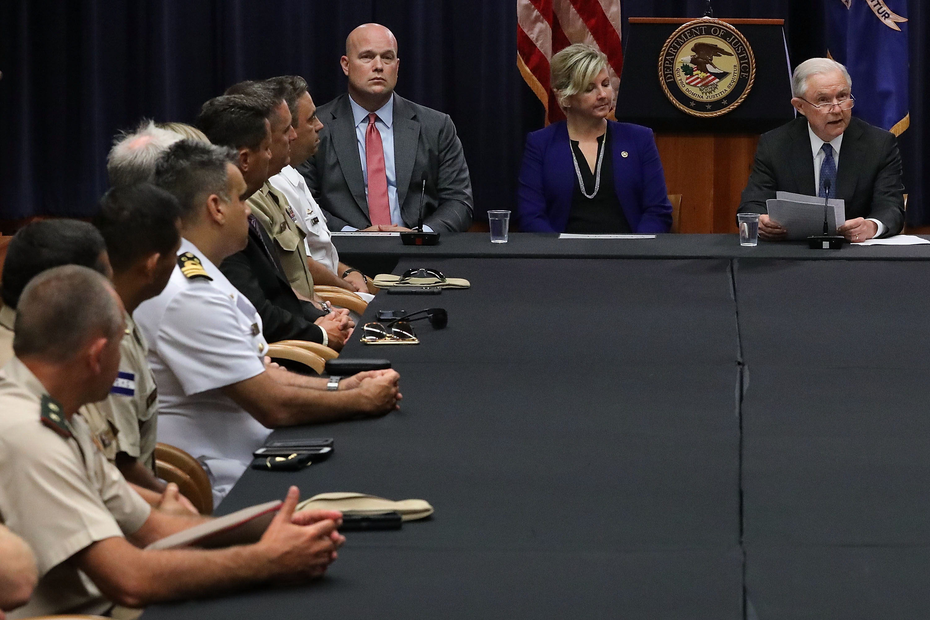 (L-R) Department of Justice Chief of Staff Matt Whitaker, the FBI's Kristi Johnson and U.S. Attorney General Jeff Sessions participate in a round table event with the Joint Interagency Task Force - South (JIATF-S) foreign liaison officers and at the Department of Justice Kennedy building August 29, 2018 in Washington, DC. (Chip Somodevilla/Getty Images)