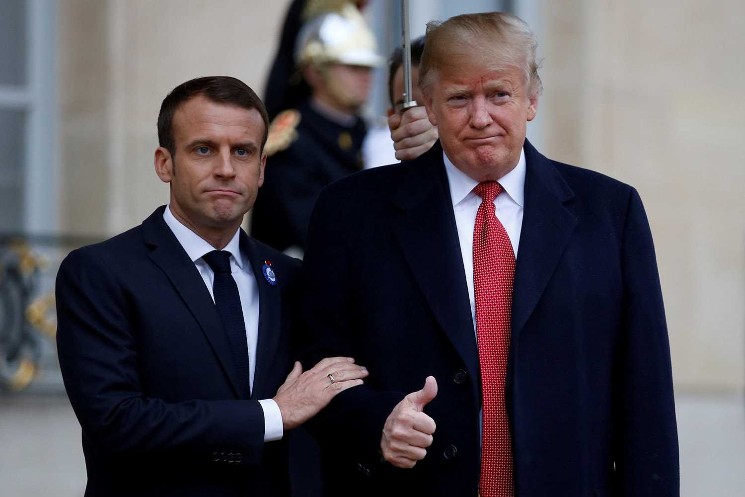 French President Emmanuel Macron welcomes U.S. President Donald Trump at the Elysee Palace on the eve of the commemoration ceremony for Armistice Day, 100 years after the end of the First World War, in Paris, France, November 10, 2018. REUTERS/Vincent Kessler