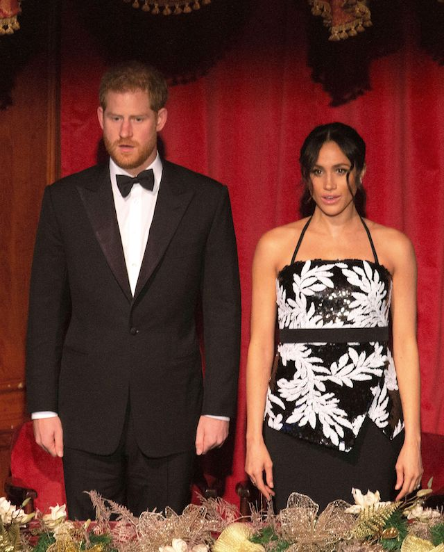 Britain's Prince Harry (L), Duke of Sussex, and his wife Meghan, Duchess of Sussex, attend the annual Royal Variety Performance at the Palladium Theatre in central London on November 19, 2018. (Photo credit: IAN VOGLER/AFP/Getty Images)