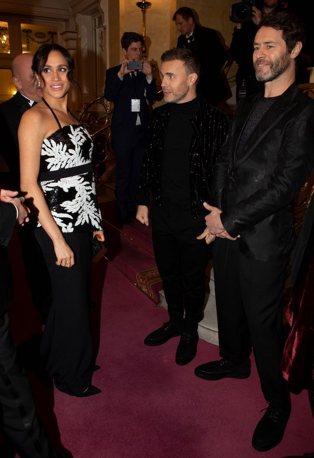 Meghan (L), Duchess of Sussex, meets members of British band Take That, Gary Barlow (C) and Howard Donald as she attends the annual Royal Variety Performance at the Palladium Theatre in central London on November 19, 2018. (Photo credit: IAN VOGLER/AFP/Getty Images)