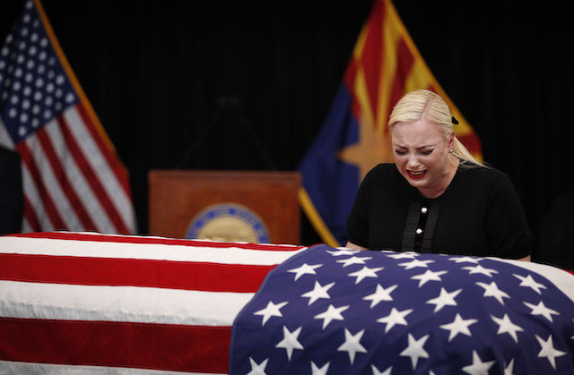 Meghan McCain, daughter of Sen. John McCain, touches the casket during a memorial service at the Arizona Capitol on August 29, 2018, in Phoenix, Arizona. John McCain will lie in state at the Arizona State Capitol before being transported to Washington D.C. where he will be buried at the U.S. Naval Academy Cemetery in Annapolis. Sen. McCain, a decorated war hero, died August 25 at the age of 81 after a long battle with Glioblastoma, a form of brain cancer. (Photo by Jae C. Hong - Pool/Getty Images)