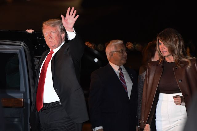 US President Donald Trump and First Lady Melania Trump disembark from Air Force One upon arrival at Ezeiza International airport in Buenos Aires, Argentina, on November 29, 2018, as they travel to attend the G20 summit. - US President Donald Trump jets into Argentina on Thursday for a G20 summit, keen to do battle with China on trade and sharpening his rhetoric against Russia over Ukraine. (Photo credit: LOEB/AFP/Getty Images)