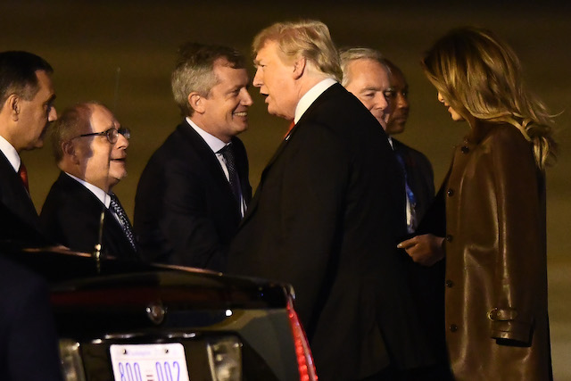 U.S. President Donald Trump and his wife Melania Trump are welcomed by Foreign Affairs Minister Jorge Faurie, President of Argentine Chamber of Deputies Emilio Monzó and Provisional president of the Argentine Senate Federico Pinedo on their arrival to Buenos Aires for G20 Leaders' Summit 2018 at Ministro Pistarini International Airport on November 29, 2018 in Ezeiza, Buenos Aires, Argentina. Leaders of the G20 group of nations are meeting for the November 30th - December 1st summit. (Photo by Amilcar Orfali/Getty Images)