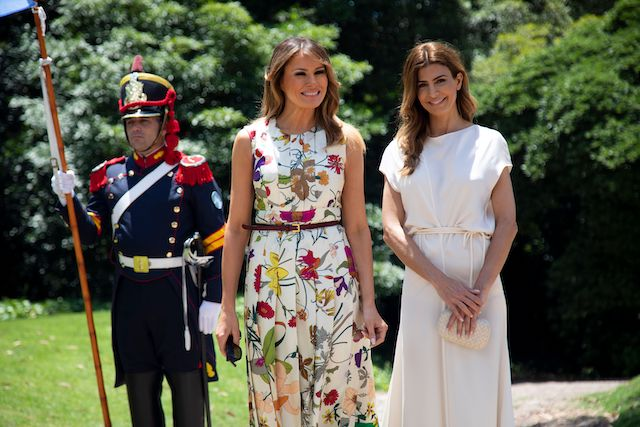 US First lady Melania Trump (L) is received by Argentina's First Lady Juliana Awada at Villa Ocampo in San Isidro, Buenos Aires province on November 30, 2018, in the sidelines of the G20 Summit. (Photo credit: ERIKA VILLANO/AFP/Getty Images)