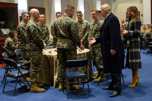 US President Donald Trump and First Lady Melania Trump talk with US Marines as they visit the Marine Barracks in Washington DC, on November 15, 2018. - Trump met with Marines who responded to a fire at the Arthur Capper Public Housing complex on September 9, 2018. (Photo credit: JIM WATSON/AFP/Getty Images)