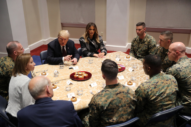 U.S. President Donald Trump speaks next to first lady Melania Trump during a tour of the U.S. Marine Barracks in Washington, U.S., November 15, 2018. REUTERS/Jonathan Ernst