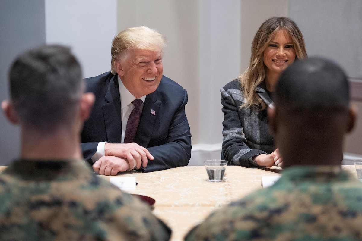 US President Donald Trump (C) and First Lady Melania Trump talk with US Marines as they visits the Marine Barracks in Washington DC, on November 15, 2018. - Trump met with Marines who responded to a fire at the Arthur Capper Public Housing complex on September 9, 2018. (Photo credit:JIM WATSON/AFP/Getty Images)