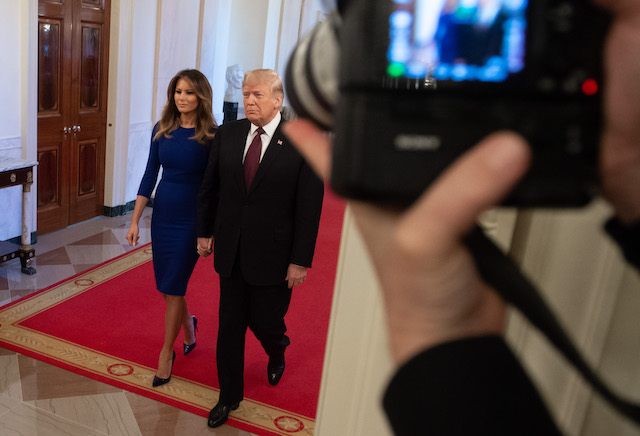 US President Donald Trump and First Lady Melania Trump arrive to award the Presidential Medal of Freedom during a ceremony in the East Room of the White House in Washington, DC, November 16, 2018. - The Medal is the highest civilian award of the United States. (Photo credit: SAUL LOEB/AFP/Getty Images)
