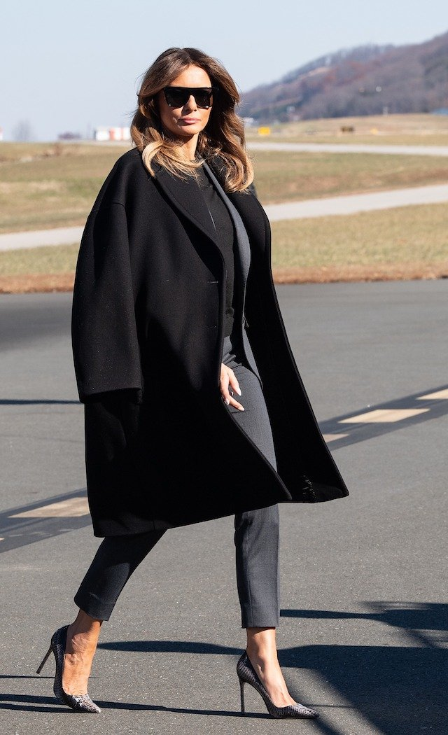 US First Lady Melania Trumps walks to board her plane after participating in a roundtable discussion on opioids at Liberty University in Lynchburg, Virginia, on November 28, 2018. (Photo credit: NICHOLAS KAMM/AFP/Getty Images)