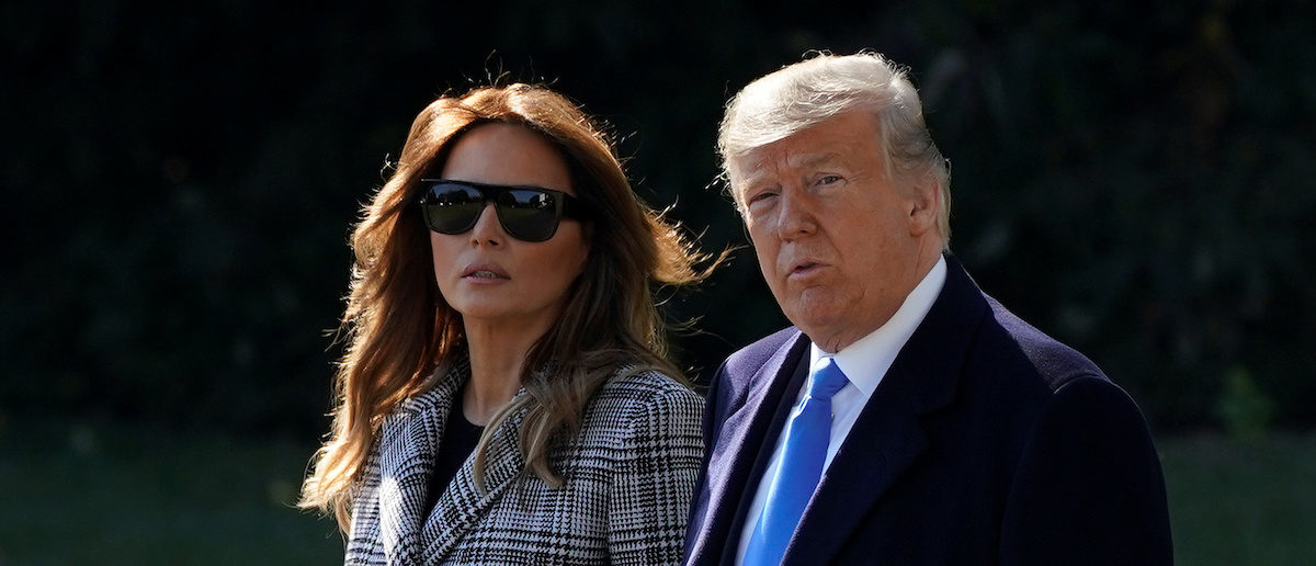 U.S. President Donald Trump and U.S. first lady Melania Trump walk to Marine One as they depart for Pittsburgh from the South Lawn of the White House in Washington, U.S., October 30, 2018. REUTERS/Joshua Roberts