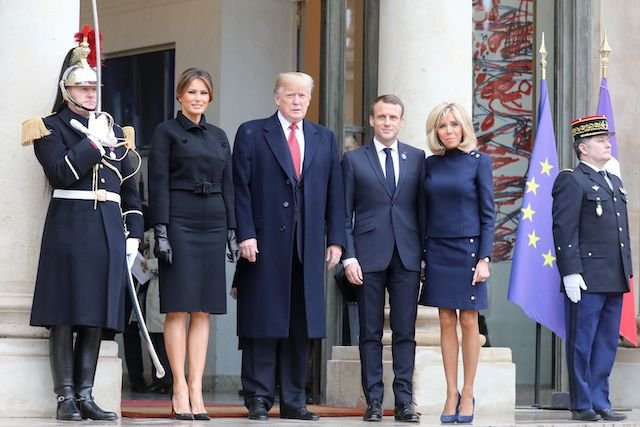 US President Donald Trump (2L) poses with French President Emmanuel Macron (2R) next to US First Lady Melania Trump (L) and French President's wife Brigitte Macron at the Elysee Palace in Paris on November 10, 2018 following bilateral talks on the sidelines of commemorations marking the 100th anniversary of the 11 November 1918 armistice, ending World War I. (Photo credit: LUDOVIC MARIN/AFP/Getty Images)