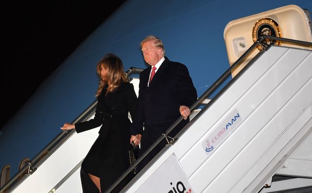 US President Donald Trump (R) and US First Lady Melania Trump arrive at Orly airport, outside Paris on November 9, 2018, ahead of commemorations marking the 100th anniversary of the 11 November 1918 armistice, ending World War I. (Photo credit: SAUL LOEB/AFP/Getty Images)