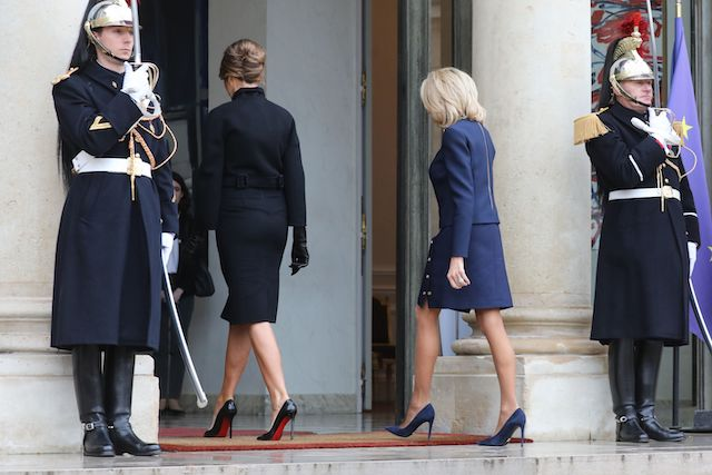 US First Lady Melania Trump (L) arrives for a meeting with French President's wife Brigitte Macron at the Elysee Palace in Paris on November 10, 2018, on the sidelines of commemorations marking the 100th anniversary of the 11 November 1918 armistice, ending World War I. (Photo credit: LUDOVIC MARIN/AFP/Getty Images)