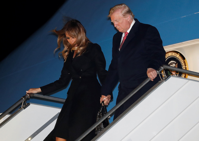 U.S. President Donald Trump and first lady Melania Trump exit Air Force One as they arrive at Orly Airport near Paris to attend commemoration ceremonies for Armistice Day, 100 years after the end of the First World War, France, November 9, 2018. REUTERS/Carlos Barria