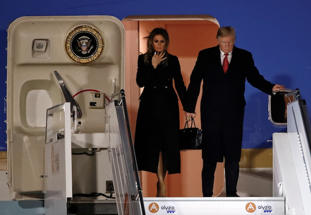 U.S. President Donald Trump and first lady Melania Trump exit Air Force One as they arrive at Orly Airport near Paris to attend commemoration ceremonies for Armistice Day, 100 years after the end of the First World War, France, November 9, 2018. REUTERS/Christian Hartmann