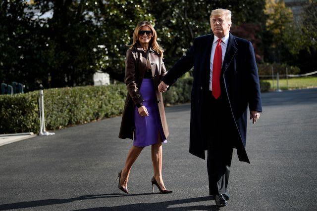 """US First Lady Melania Trump and US President Donald Trump walk to Marine One on the South Lawn of the White House November 29, 2018 in Washington, DC. - Trump said Thursday a weekend G20 summit of world leaders would be a """"very good time"""" for a meeting with Russian leader Vladimir Putin. (Photo credit: BRENDAN SMIALOWSKI/AFP/Getty Images)"""