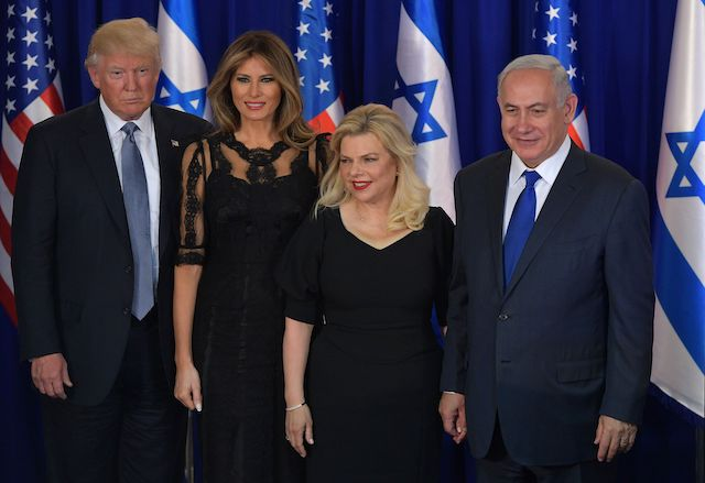 US President Donald Trump, first lady Melania Trump, Sara Netanyahu and Israel's Prime Minister Benjamin Netanyahu pose for pictures before an official dinner in Jerusalem on May 22, 2017. (Photo credit: MANDEL NGAN/AFP/Getty Images)