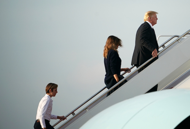 US President Donald Trump (R), First Lady Melania Trump and their son Barron make their way to board Air Force One before departing from Palm Beach International Airport in West Palm Beach, Florida on November 25, 2018. - Trump is returning to Washington after spending the Thanksgiving holiday at his Mar-a-Lago resort. (Photo credit: MANDEL NGAN/AFP/Getty Images)