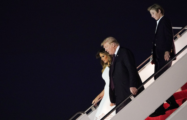 US President Donald Trump, First Lady Melania Trump and their son Barron step off Air Force One upon arrival at Palm Beach International Airport in West Palm Beach, Florida on November 20, 2018. - Trump will be spending the Thanksgiving holiday at his Mar-a-Lago resort. (Photo credit: MANDEL NGAN/AFP/Getty Images)