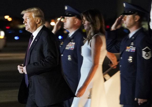 US President Donald Trump and First Lady Melania Trump step off Air Force One upon arrival at Palm Beach International Airport in West Palm Beach, Florida on November 20, 2018. - Trump will be spending the Thanksgiving holiday at his Mar-a-Lago resort. (Photo credit: MANDEL NGAN/AFP/Getty Images)
