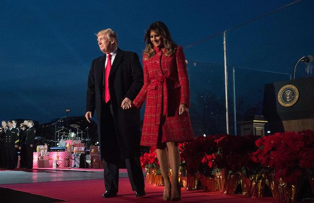 US President Donald Trump and First Lady Melania Trump walk off the stage during the 95th annual National Christmas Tree Lighting ceremony at the Ellipse in President's Park near the White House in Washington, DC on November 30, 2017. (Photo credit: NICHOLAS KAMM/AFP/Getty Images)
