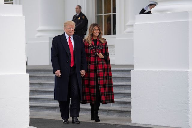 US President Donald Trump and First Lady Melania Trump participate in the White House Christmas Tree delivery at the White House in Washington, DC, on November 19, 2018. (Photo credit: JIM WATSON/AFP/Getty Images)