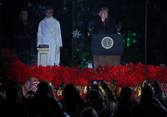 U.S. President Donald Trump and first lady Melania Trump (L) attend the National Christmas Tree lighting ceremony held by the National Park Service at the Ellipse near the White House on November 28, 2018 in Washington, DC. This is the 96th annual National Christmas Tree Lighting Ceremony. (Photo by Mark Wilson/Getty Images)