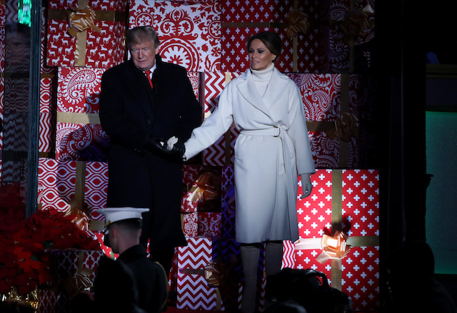 U.S. President Donald Trump and first lady Melania Trump attend the National Christmas Tree lighting ceremony held by the National Park Service at the Ellipse near the White House on November 28, 2018 in Washington, DC. This is the 96th annual National Christmas Tree Lighting Ceremony. (Photo by Mark Wilson/Getty Images)