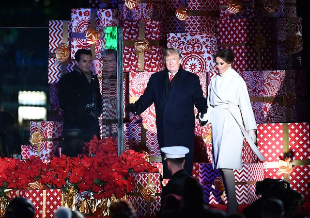 US President Donald Trump, and First Lady Melania Trump arrive to light the National Christmas Tree on the National Mall in Washington, DC, on November 28, 2018. (Photo credit: BRENDAN SMIALOWSKI/AFP/Getty Images)