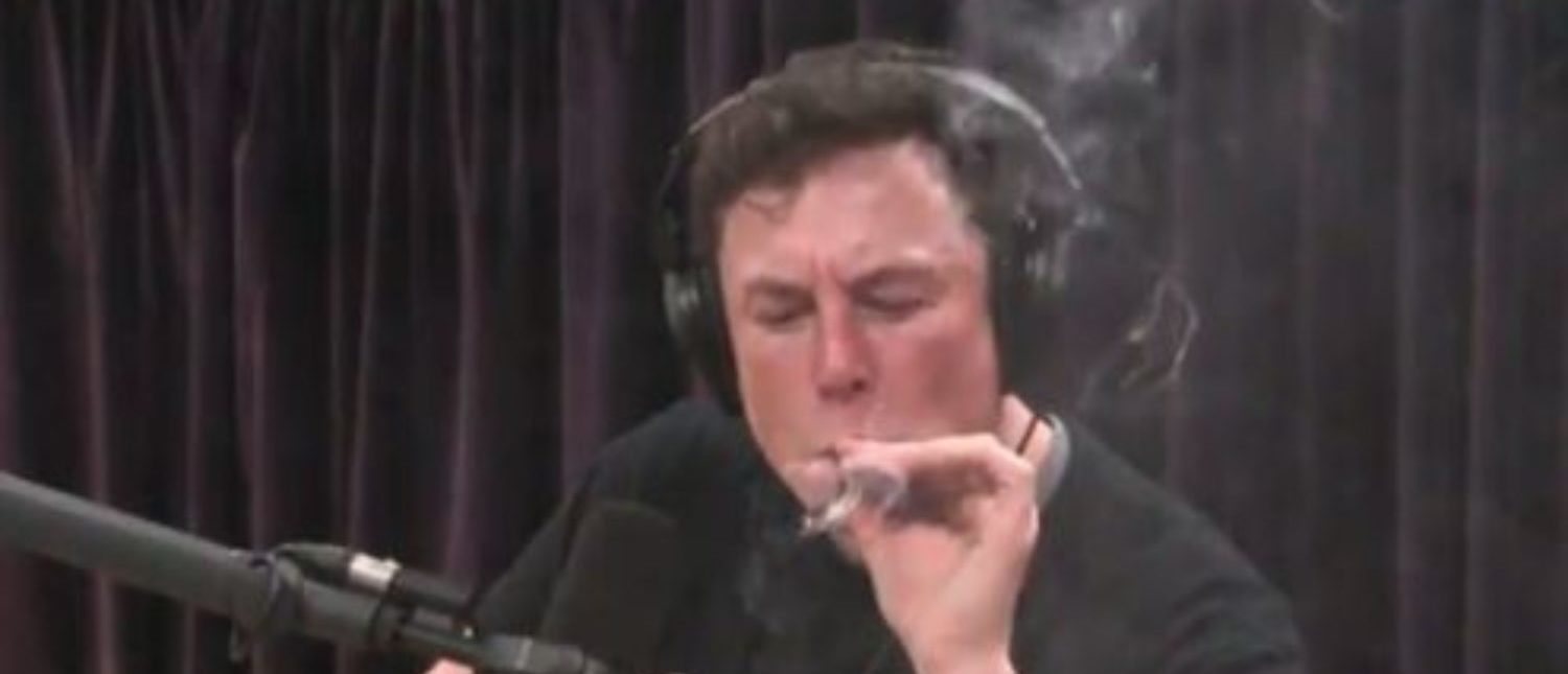 Elon Musk takes a drag off a marijuana cigarette during Joe Rogan's podcast (snapshot of YouTube)