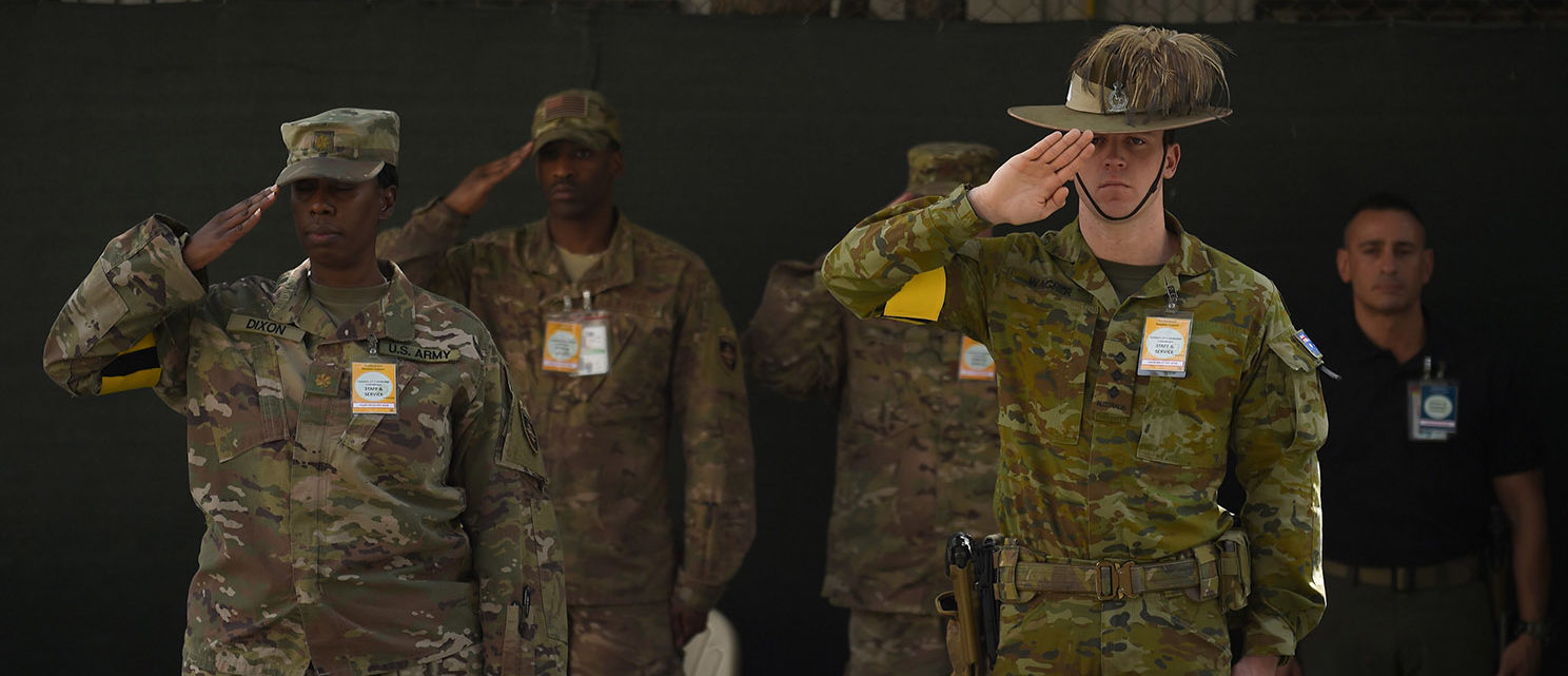 US military personnel and an Australian NATO forces soldier salute during a change of command ceremony at Resolute Support in Kabul on September 2, 2018. WAKIL KOHSAR/AFP/Getty Images
