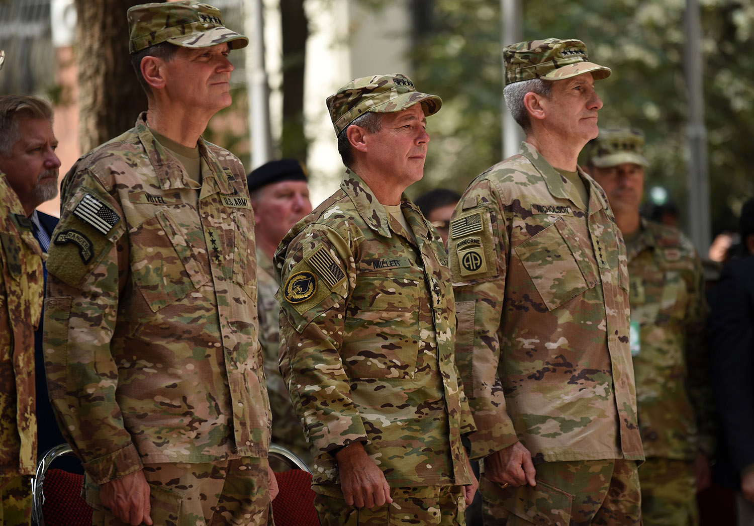 Incoming General Scott Miller (C), command of US and NATO forces in Afghanistan, outgoing U.S. Army General John Nicholson (R) and U.S. army General Votel (L) look on during a change of command ceremony at Resolute Support in Kabul on September 2, 2018. - General Scott Miller took command of US and NATO forces in Afghanistan on September 2, as worsening violence erodes hopes for peace in the war-torn country. WAKIL KOHSAR/AFP/Getty Images)