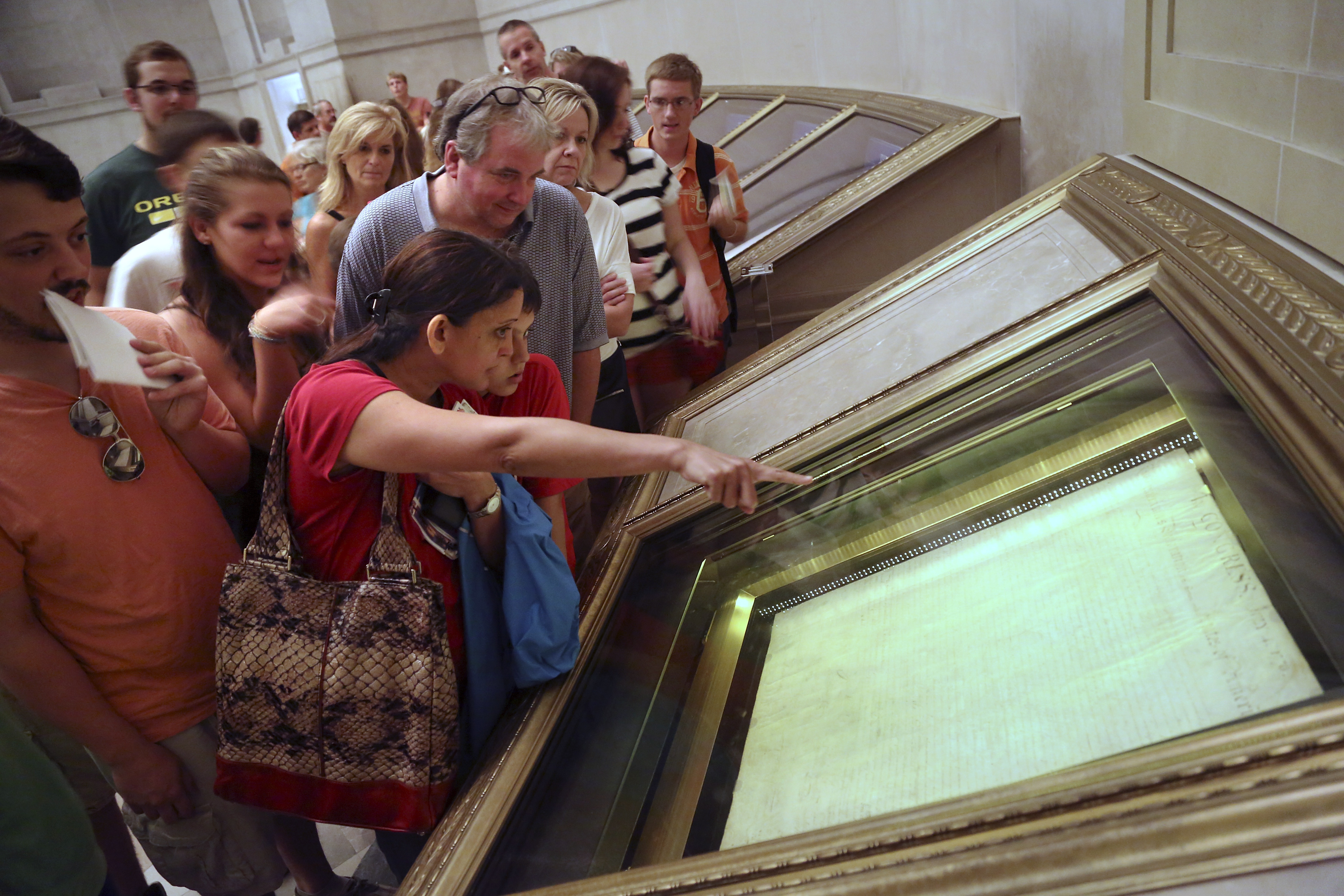 FILE -- Visitors to the National Archives view the Declaration of Independence, preserved under glass and special lighting, ahead of the Fourth of July Independence Day holiday in Washington, July 3, 2013. REUTERS/Jonathan Ernst