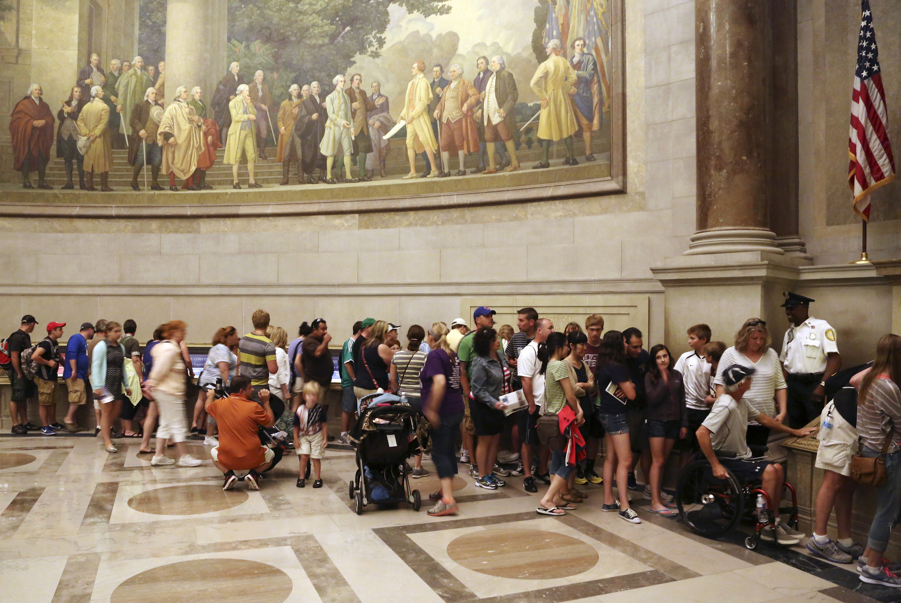 FILE -- Visitors wait in line at the National Archives to view the Declaration of Independence, preserved under glass and special lighting, ahead of the Fourth of July Independence Day holiday in Washington, July 3, 2013. REUTERS/Jonathan Ernst