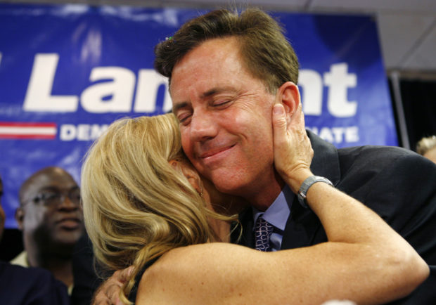 Millionaire cable television executive Ned Lamont embraces his wife Annie as he celebrates with his supporters after winning the Connecticut Democratic primary election for U.S. Senate at his election night headquarters in Meriden, Connecticut, August 8, 2006. Lamont defeated three-term Senate veteran and one-time Democratic vice presidential candidate Joseph Lieberman. REUTERS/Mike Segar